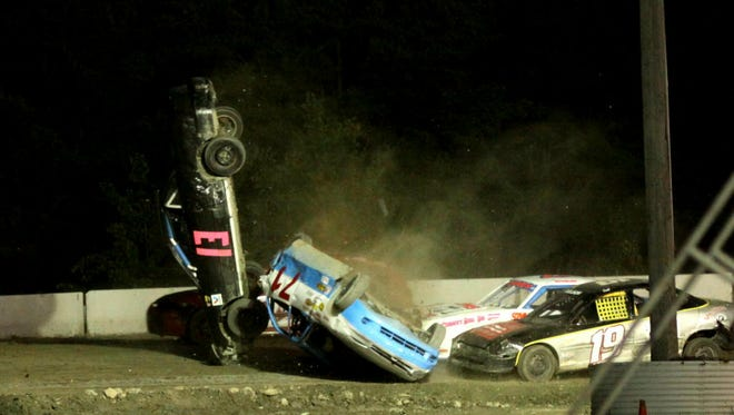 Jason Porter (#13) and Rodney Davis (#71) go for a pair of wild flips at Bear Ridge Speedway in Bradford on Saturday night.  Neither driver was injured.