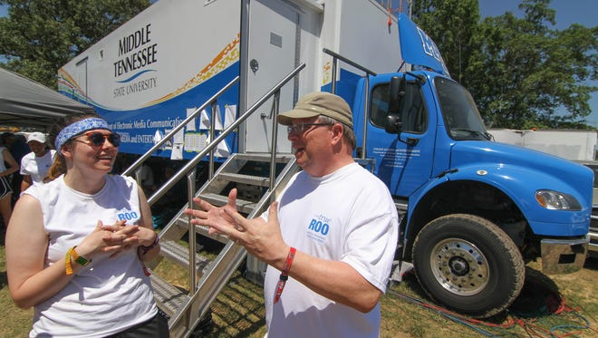 MTSU's Bob Gordon, video production faculty in the Department of Electronic Media Communication, talks Friday, June 10, with MTSU student production manager Kaelin Michelle Bastin after the afternoon's first performance on the Who Stage at the 2016 Bonnaroo Music and Arts Festival in Manchester, Tenn. Bastin is a senior video production major from Springville, Utah.
