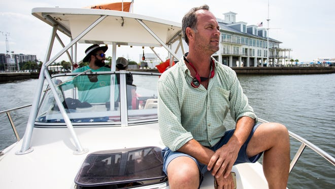 Captain Ted Gray, left, and Jefferson's owner Trey Zoeller aboard the boat that carried two bourbon barrels from Louisville to New Orleans.