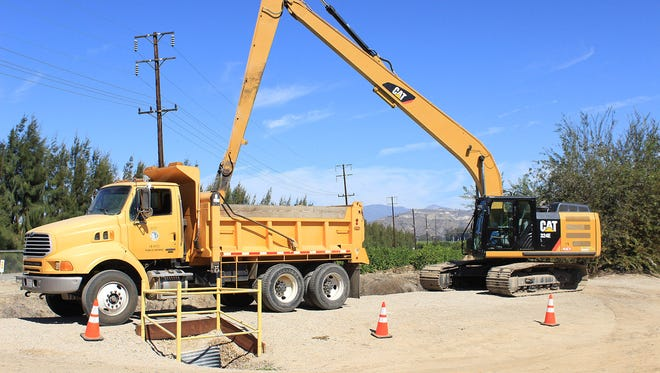 Crews from the Ventura County Public Works Agency clear a flood control channel as part of last year's Flood Preparedness Week activities. This year's activities will take place Oct. 24-29.