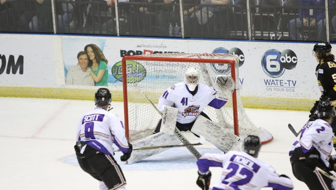 Ice Bears goalie Brian Billett defends the goal Tuesday during the game against the Mississippi RiverKings.