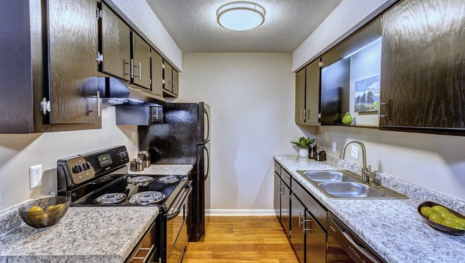 A renovated kitchen with new appliances at Elevation Knoxville, formerly Country Oaks Apartments.