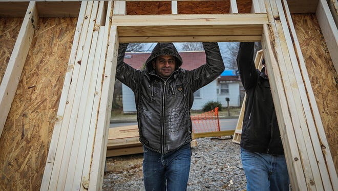 Andrew Benyamin helps raise a wall in his new home, which is being constructed through Habitat for Humanity of Rutherford County. His home in Smyrna will be finished in April.