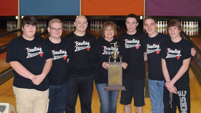 Bucyrus boys pose with their trophy after beating Galion in the final. (L to R): Kadin Sims, Austin Edgington, Jo Metz, coach Diane Kaple, Alexx Moore, Austin Johns, Zacc Moore.