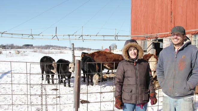 Merrie Schamberger, NRCS Winnebago County District Conservationist, and Justin Duell, The G Farm Owner, view cattle by the barn.
