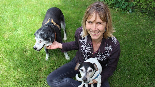 Writer Amy Sutherland, a native of Cincinnati, poses with her dogs Penny Jane left) and Walter Joe. She is reading from her book 7 p.m. Wednesday at Joseph-Beth Booksellers in Rookwood.