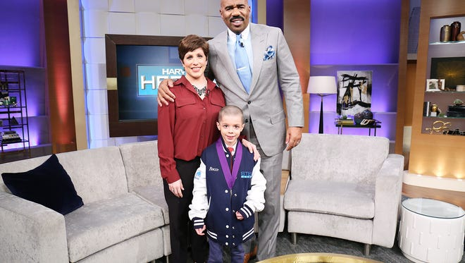 "Marlton's Rocco Regalbuto (center) will be honored as a ""Harvey's Hero"" on ""Steve Harvey,"" which will air on Thursday. He's being honored for helping to save his mother's life in March by calling 911. His mother Danielle Regalbuto (left) is pictured next to Steve Harvey."