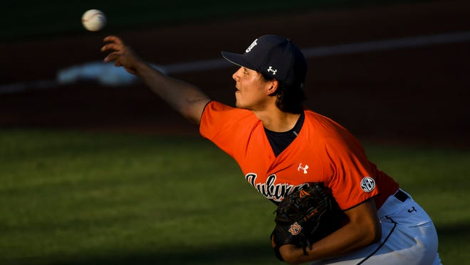 Auburn pitcher Christian Camacho took the loss after giving up four runs in 4 1/3 innings as Troy defeated the No. 7 Tigers 5-2 on Tuesday, April 25, 2017, in Auburn, Ala.