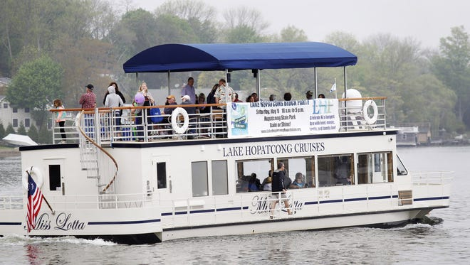 "Boating enthusiasts take a lake cruise on the ""Miss Lotta"" a Lake Hopatcong Lake Cruises service boat during the block party held at Lake Hopatcong State Park in Landing. Boating enthusiasts take a lake cruise on the ""Miss Lotta""  a new Lake Hopatcong Lake Cruises service boat during the Lake Hopatcong Block Party, held at Lake Hopatcong State Park, in Landing.    5/9/2015 Photo for The Morris Daily Record by Jerry McCrea"