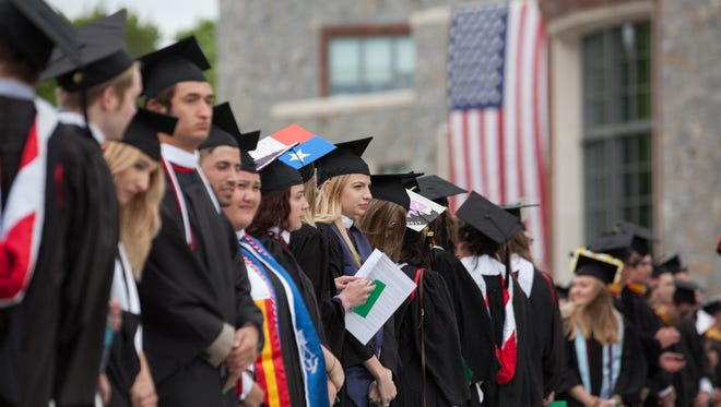 Marist College Class of 2017 graduates celebrate their commencement ceremony at the schools campus in Poughkeepsie, May 20, 2017