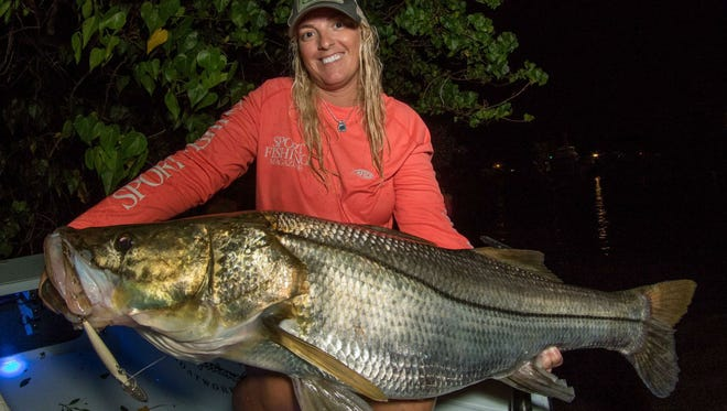 Regina Gallant, of Fort Lauderdale, caught and released this snook Tuesday night measuring 49 inches in length. Gallant, fishing with marine artist Adrian Gray, also of Fort Lauderdale, caught it using a Rapala CD 14 with single hooks.