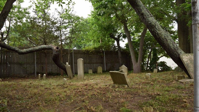 Volunteers cleaned up a 19th century cemetery in Berkeley's Bayville section on Saturday, June 17.