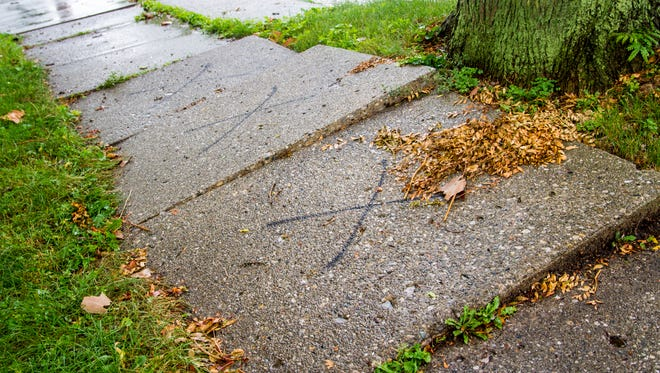 Sidewalks are marked in one Marine City neighborhood. The city is rolling out its sidewalk program, and the residents in the first section of four have been notified they have sidewalks they need to repair or replace.