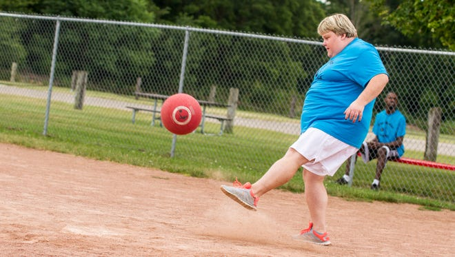 Dirt flies as Molly Whiting kicks the ball during the kickball tournament benefit for the Blue Water Center for Independent Living and The arc on aug 11. The event gives people who wouldn't normally be interested in competitive sports a fun opportunity to play.