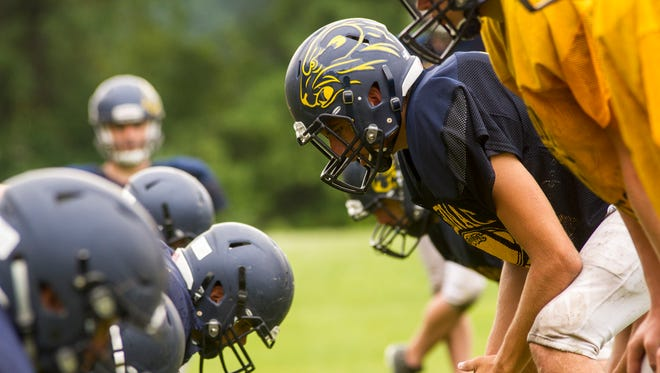 An Algonac High School Muskrat waits for a play to begin during a practice on Aug. 15. The Muskrats' first game will be against Marine City on Aug. 24.