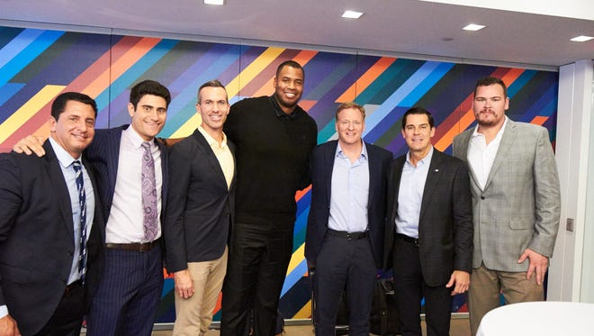 NFL Pride founders John Cora and Michael Castor, Outsports co-founder Cyd Zeigler, former NBA player Jason Collins, NFL commissioner Roger Goodell, former MLB player Billy Bean and former NFL player Ryan O'Callaghan pose for a photo.
