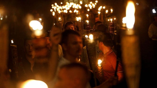 """Multiple white nationalist groups march with torches through the University of Virginia campus in Charlottesville. When they were met by counterprotesters, some yelling """"Black lives matter,"""" tempers turned into violence. Multiple punches were thrown, pepper spray was sprayed, and torches were used as weapons."""