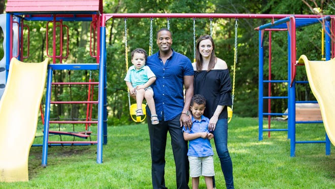 Businessman John James, shown here with his family, is running as a Republican for a U.S. Senate seat in Michigan