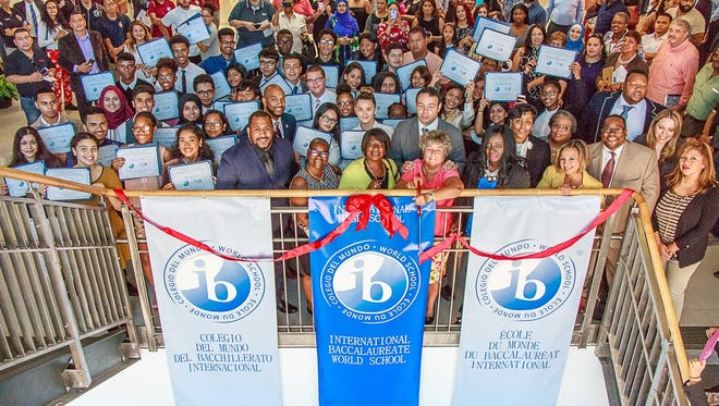 Students and staff celebrate Paterson's International Baccalaureate program.