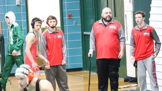 Shelby wrestling coach Ted Tonn reached his goal of walking again by the first wrestling meet after needing surgery on both knees in September.