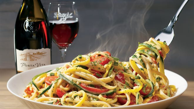 Spiralized Veggie Pasta: A combination of zucchini and squash noodles, tossed with whole grain linguine, tomatoes and garlic in a scampi herb sauce.