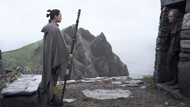 """Daisy Ridley and Mark Hamill square off in """"Star Wars: The Last Jedi."""""""