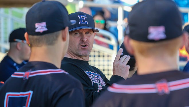 Escambia High head coach Tracey King gives last minute instructions to his team before the start of the Gators game against Mosley in the Battle at the Bayfront baseball tournament at Blue Wahoos Stadium on Tuesday, March 20, 2018.