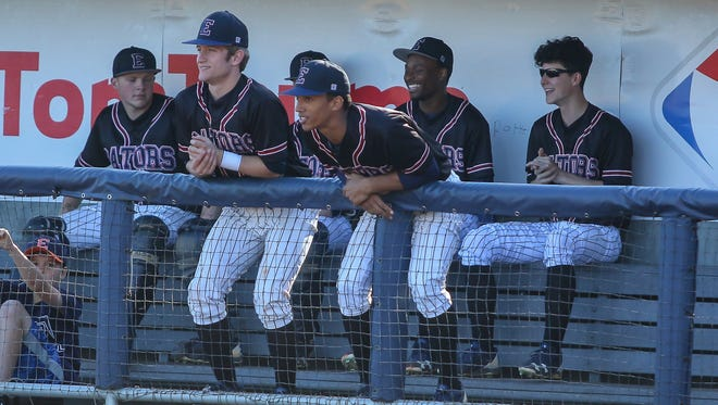 Escambia players look on during the game against Mosley in the Battle at the Bayfront baseball tournament at Blue Wahoos Stadium on Tuesday, March 20, 2018.
