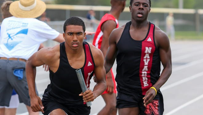 Navarre's Dante Wright takes the baton handoff and races the last leg of the 4x400m relay in the Andrews Invitational at Gulf Breeze High School on Thursday, March 29, 2018.