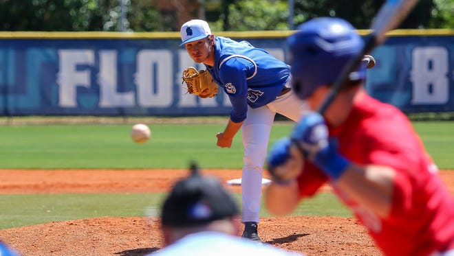 UWF's Hunter Lucas (34) pitches to West Georgia's Cade Marlowe (10) on Jim Spooner Field at the University of West Florida on Saturday, March 31, 2018.