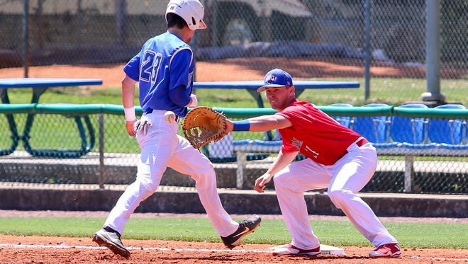 UWF's Matthew Jones (23) easily beats the pick-off throw to West Georgia first baseman Ben Utley (14) on Jim Spooner Field at the University of West Florida on Saturday, March 31, 2018.