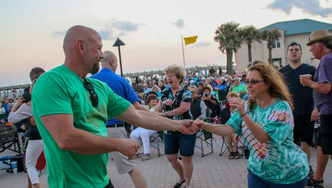 Hundreds of people enjoy the first night of Bands on the Beach, featuring Gretsch Lyles and the Modern Eldorados, at the Pensacola Beach Gulfside Pavilion on Tuesday, April 3, 2018. The free, weekly concert series features a different band every Tuesday at 7p.m. through October 30.