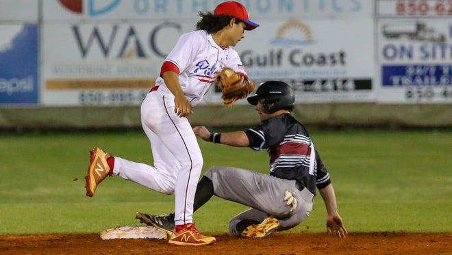Tate's Reid Halfacre (1) steals second base before Pace shortstop Caleb Vincent (24) can bring down the throw from home plate during the District 1-7A game at Pace High School on Friday, April 13, 2018.