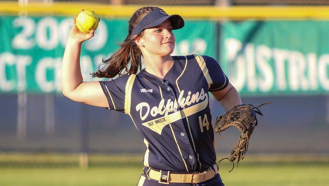 Gulf Breeze's Reagan Raley (14) throws the ball back in after catching a pop-up hit by a Mosley player in the Region 1-6A quarterfinal game at Gulf Breeze High School on Wednesday, May 2, 2018.  Gulf Breeze won 4-2 and will move on to the Region 1 semifinal game for the second straight year.