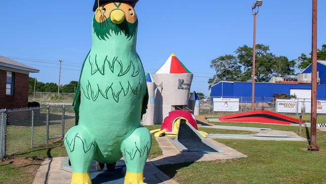 Shown on Wednesday, May 2, 2018, a few of the holes on The First Tee of Northwest Florida's goofy golf course, located at 3924 W. Navy Blvd., include moving obstacles such as a windmill that players have to navigate past to sink their putts. Sponsors have stepped in to help give the figures at each hole new life with restoration and fresh paint.