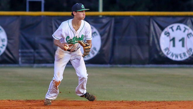 Pensacola Catholic second baseman Donovan Whibbs (28) fields a ball hit by Jacksonville Trinity Christian Academy's Bryan Muniz and throws him out at first base in the Region 1-4A semifinal game at PCHS on Wednesday, May 9, 2018.