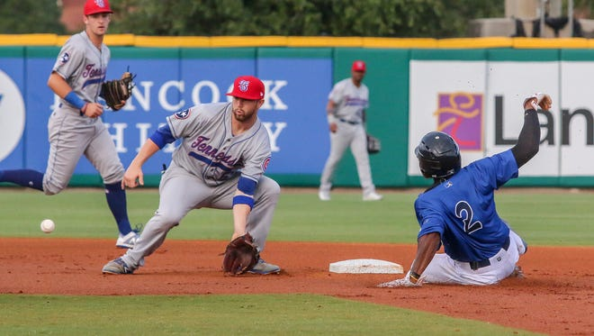 Pensacola's C.J. McElroy (2) beats the throw to Tennessee's Trent Giambrone (6) and easily steals second base during Dr. James Andrews Appreciation Night at Blue Wahoos Stadium on Friday, May 25, 2018.