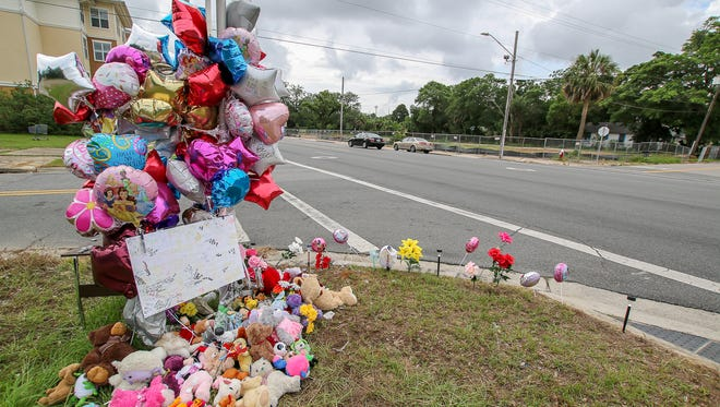 """Flowers, stuffed aniamls, balloons, and other mementos are placed at a makeshift memorial at West Cervantes and """"M"""" streets on Tuesday, June 12, 2018, for Nephateria Monique Williams, 28, and 8-month-old Neariaah Ikerria Williams, who were killed on June 6 when a driver hit them and the child's mother, Quineka Tyon Baldwin, 27, as they were crossing West Cervantes St. Police are still searching for the unknown driver and the car, a white 2015-2018 Dodge Challenger, after the driver fled from the scene."""