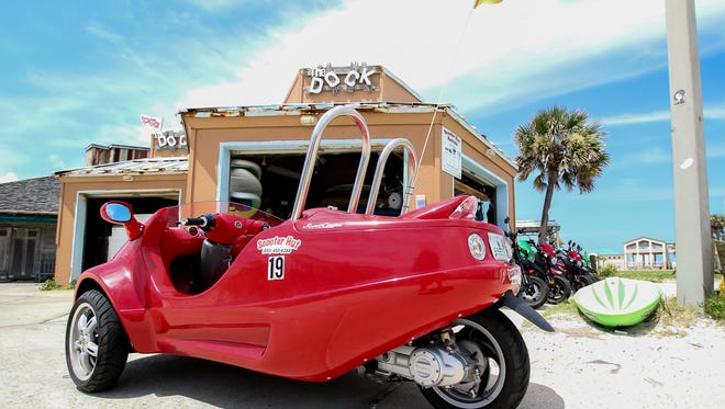 Shown on Thursday, June 21, 2018, Scooter Hut Rentals, located near the entrance of The Dock on Pensacola Beach, added two Scoot Coupes in February of this year to its list of items people can rent by the hour or day. Manufactured by Panther Motors in Tamarac, Fla., the three-wheeled gas-powered vehicles are street legal, seat two adults, and have a small storage space behind the passengers.