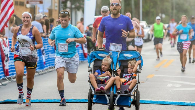 Runners make their way through downtown Pensacola during last year's Ronald McDonald House Charities Firecracker 5K. This year's event gets underway at 7 a.m. Saturday.