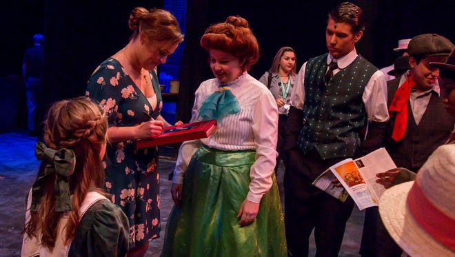 """Broadway star and Gulf Breeze native Ashley Brown signs an autograph for Lindsay Riddle, 24, dance captain of the Pensacola Little Theatre's production of """"Mary Poppins,"""" on Thursday, August 2, 2018."""