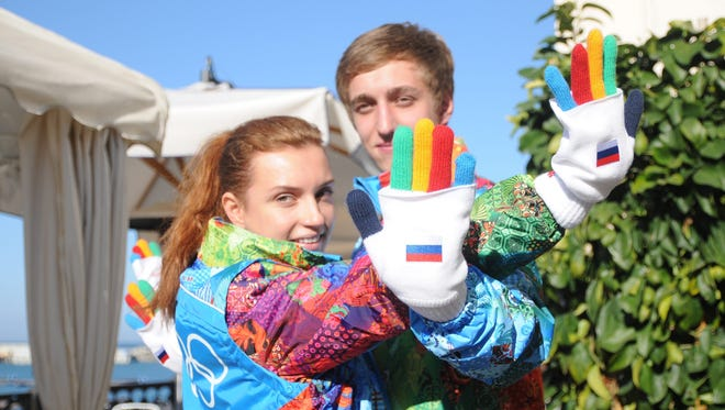 Volunteers pose during the presentation of their outfits for the Sochi Winter Olympics in Sochi, Russia, Oct. 30.