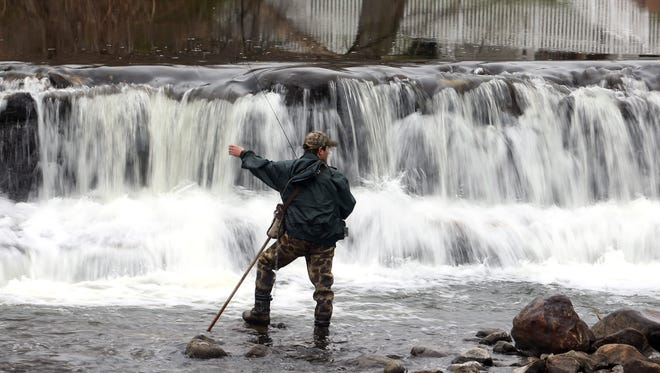 Fishing for trout on the Rockaway River in Morris County.