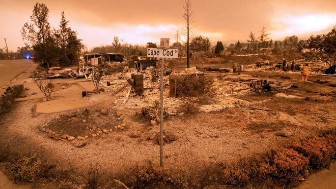Burned out properties are seen near the Lake Keswick Estates area during the Carr fire in Redding, California on July 27, 2018. Two firefighters have died and more than 100 homes have burned as wind-whipped flames tore through the region.  / AFP PHOTO / JOSH EDELSONJOSH EDELSON/AFP/Getty Images ORIG FILE ID: AFP_17Z6QT