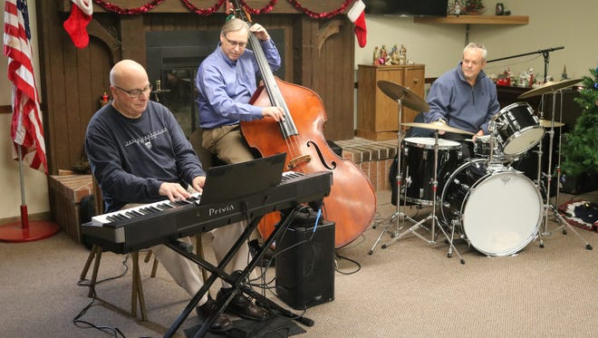 John Cleveland, Norm Damschroder and Keith McWatters, who make up the Toledo Symphony Orchestra Jazz Trio, said they love playing in the more intimate settings of smaller venues, like their performance at Elmore Retirement Village on Thursday.