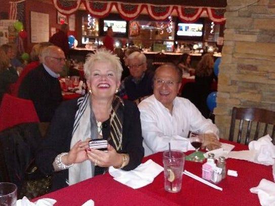 Former state representative Nora Espinoza flashes a