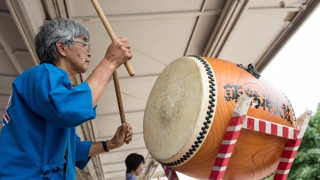 Tetsuro Atsumi plays drums during Summerfest at McCamly Park Saturday.
