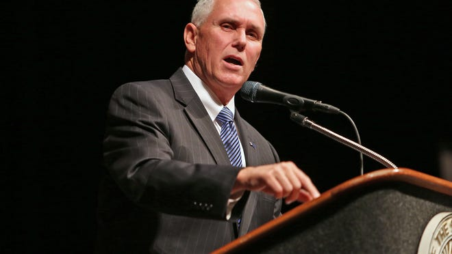 Governor Mike Pence unveils his 2015 legislative agenda during the Bingham Greenebaum Doll Legislative Conference at the Indiana Convention Center,  in Indianapolis, Thursday, Dec. 4, 2014. (AP Photo/The Indianapolis Star, Kelly Wilkinson)  NO SALES ORG XMIT: ININS102