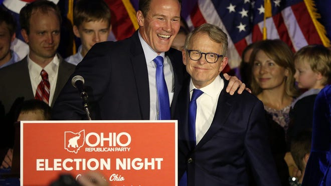 Jon Husted (left) and Mike DeWine celebrate the win for their Republican gubernatorial ticket at the GOP celebration at the Sheraton Hotel on Capitol Square on Nov. 6, 2018.