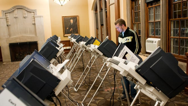 Nick Acosta, a Purdue junior studying computer graphics technology, was the last person to vote inside the Purdue Memorial Union, in West Lafayette, on Nov. 6, 2012. Voters were allowed to cast their ballots because they were in line prior to the polls closing.